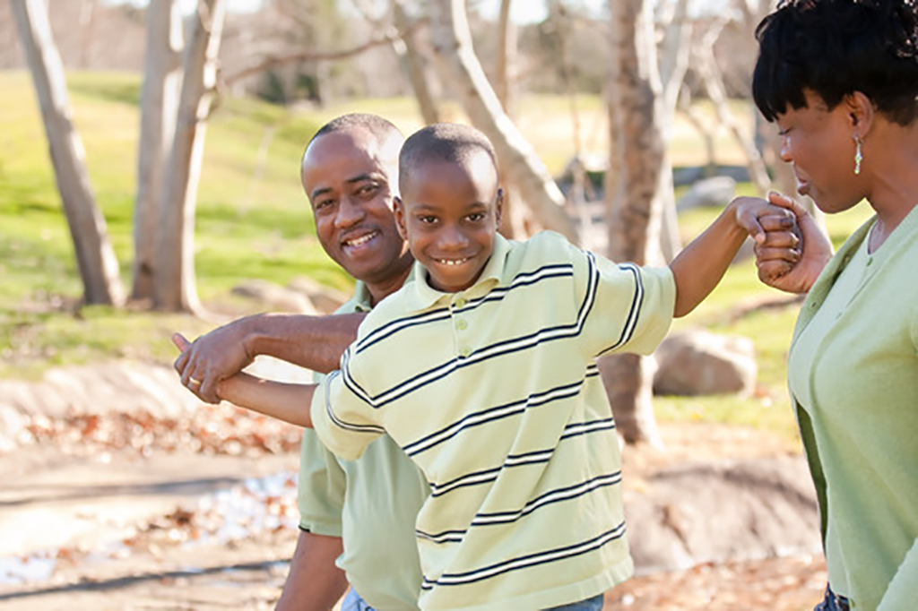 Happy African American Man, Woman and Child