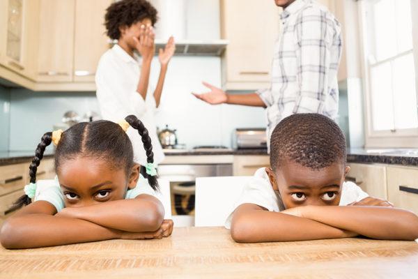 Sad siblings against parents arguing